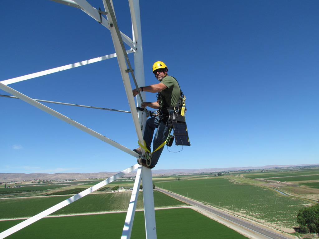Man on Cell Tower working