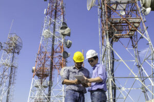 Men working near cell tower