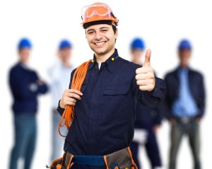 15668913 - portrait of an happy worker in front of his team